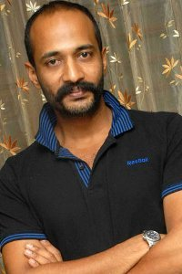 Actor Kishore in Vada Chennai , Actor Kishore photos, videos in Vada Chennai