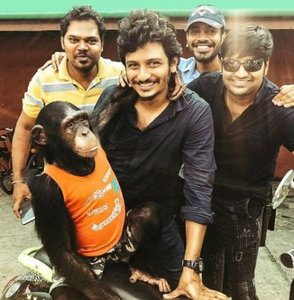 Jiiva with a chimpanzee in Thailand for a shoot