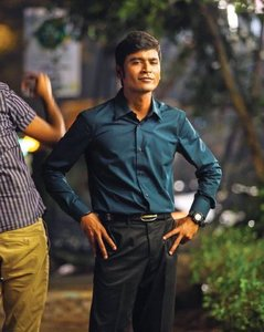 Dhanush in the movie Thangamagan